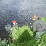 James playing a salmon, Chris with net, Wall Pool, Mount Falcon, River Moy.